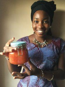 Student learning to preserve tomatoes.