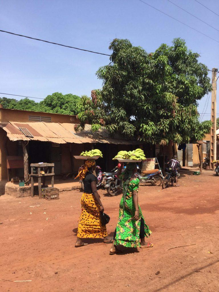 Women carry bananas on their heads to sell in Mali