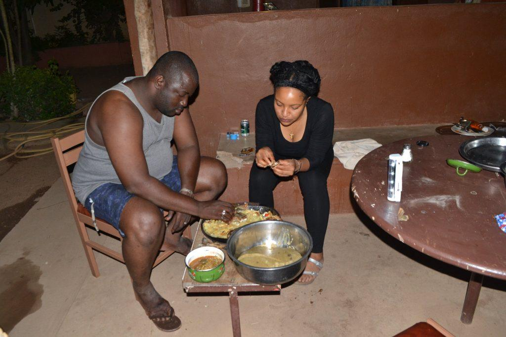 Man and woman eating Malian food