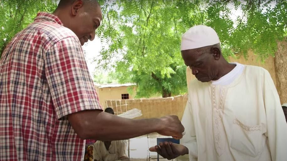 Handing out moringa seeds