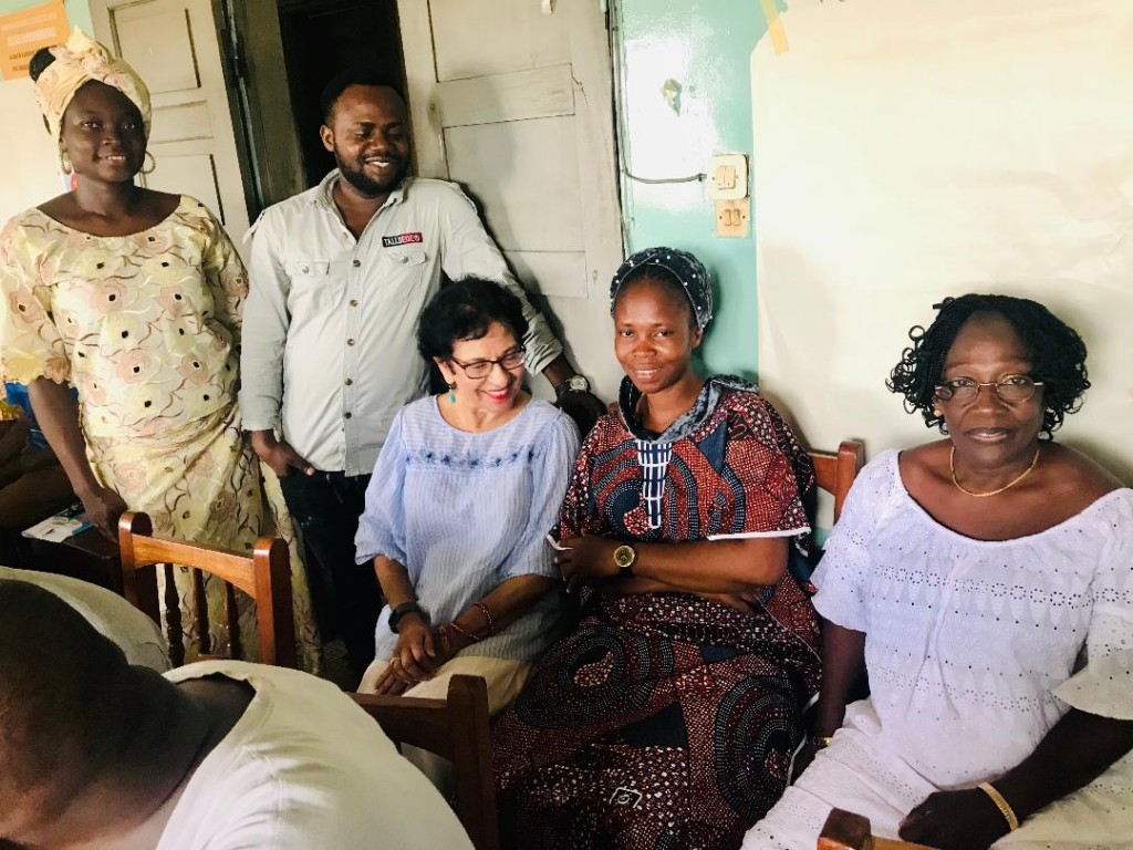 neelam with a group from mali as they sit outside a building that shows the missed connection due to remote training